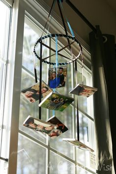 A wonderful homemade mobile made from family photos- such a sweet idea! A nice Mother's Day gift, too. #craft