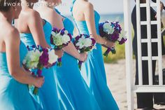 Purple stock, white lilies, hydrangea, roses & orchids for these bridesmaid bouquets.