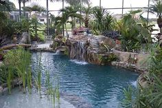 Lagoon Pool with Grotto Waterfall, Spa, and Fire Pit by Lucas Lagoons