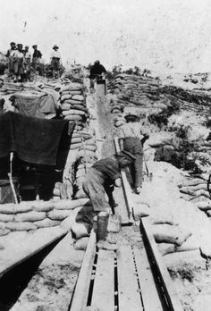 Anzac soldiers working on a mud chute at a mining operation at Quinn's Post, during the Gallipoli campaign 1915.  Miners from Australia and New Zealand dug extensively to provide communication tunnels and to destroy Turkish tunnels and trenches.
