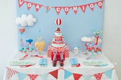 Cherry red and egg shell blue make for a great colour scheme, with some patterned bunting, a cloud or two and even a bird or hot air balloon