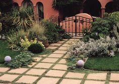 geometry for the lawn - love it.  Landscape pavers - permeable