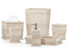 These architecturally inspired pieces are carved from single blocks of Italian travertine marble. Natural textures in the stone make each piece wonderfully unique. Designed by Alexa Hampton. Made in Italy.