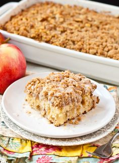 Buttery cake studded with apples and covered in a cinnamon crumb topping.