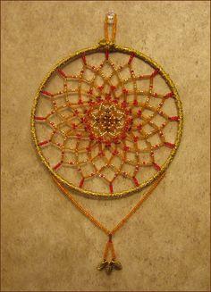 beaded dreamcatcher    Pattern from Sun Catchers Beaded Jewelry by Jeanette Shanigan