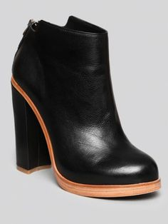 DV BY DOLCE VITA Black leather bootie featuring a slight platform and a covered block heel