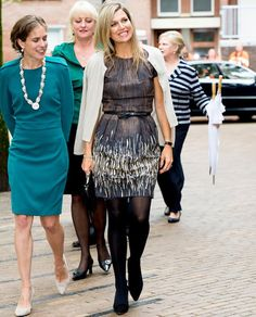Queen Maxima of The Netherlands visit the Instrumentendepot Leerorkest and hand over the Amalia violin to Sanne Wiering in Amsterdam, The Netherlands on September 16, 2015.