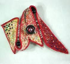Google Image Result for http://www.waiyukkennedy.co.uk/assets/brooches/textile-art-brooch-red-whit.jpg