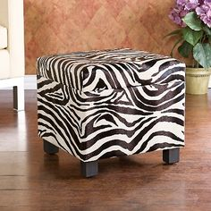 Faux-Leather Zebra Storage Ottoman - For my reading nook in my bedroom.  Still looking for the perfect chair...