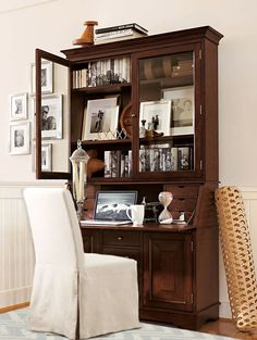 A hutch on top of a classic desk is a great place to store books and showcase art. #potterybarn