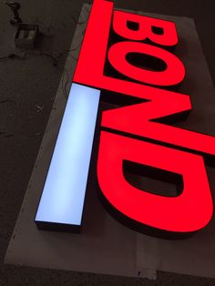 Bond channel letters; white and red. Signs wholesale.