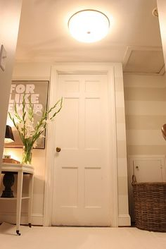 subtle wall stripes--I'd love to do this in my basement to warm up that dungeon!