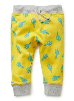 100% Cotton french terry pant. trackies with contrast ribbed waistband and cuffs. Features all-over cactus print and gusset. Relaxed fitting silhouette. Available in brilliant yellow.