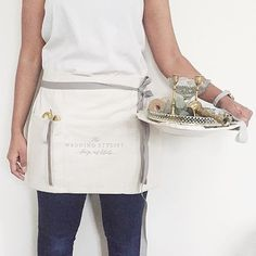 this listing is for a one of a kind vendor apron in soft oatmeal colored linen with three pockets and extra long twill ties to secure either in front or back. perfect to carry around supplies that need to be close at hand during your next event, photoshoot, cooking class, floral workshop, etc. heck, it can double as your weeknight cooking apron at home too! APRON DETAILS  :: 19 wide x 15 tall, :: 3 large front pockets (9.5 tall) :: your choice of twill tie color  :: IT IS A 7-8 WEEK…