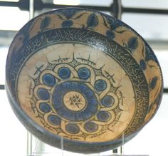Bowl. Kufic inscription. Made of black, blue underglaze pottery.1214; Kashan; Iran