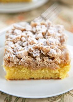 Shortcut New York Crumb Cake - yellow cake mix topped with an easy homemade crumb topping. Yellow cake mix, sugar, brown sugar, cinnamon, butter and cake flour. Super easy to make and tastes great. This cake is OUTRAGEOUSLY good! I could not stop eating it! Great for a crowd. We ate this for breakfast and dessert.