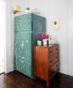 Notes and doodles cover this green-chalkboard–painted fridgr and a small wood dresser provides space for odds and ends. | Photo: Nathan Kirkman | thisoldhouse.com