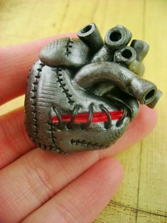 Stitched Together - Anatomically Correct Human Heart Necklace. $51.00, via Etsy.
