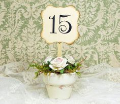 Vintage flower pot table number.  I like the antiqued detail on the Victorian card.