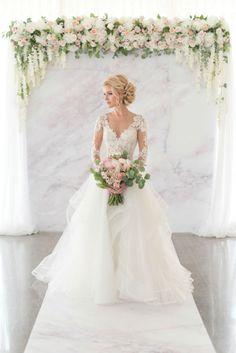 Gorgeous floral arch for a wedding ceremony! Dress: Hayley Paige NORDIC LOVE: MARBLE & GEOMETRIC WEDDING THEME www.elegantwedding.ca