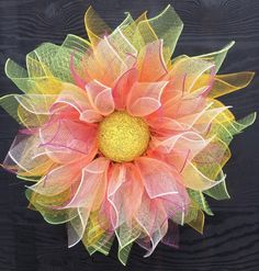 Barb Bowman shared this neat deco mesh flower wreath for #ShowAndTellTuesday. Want to learn how to do the same? Join our community of artisans like Barb today!