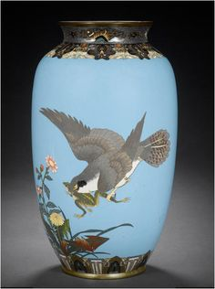 Four various cloisonné enamel vases Meiji Period  All worked in silver and gilt wire, the first decorated with an hawk swooping in to catch a leaping frog beneath a band of stylised butterflies on a blue ground;the second with doves perched among plum branches on a aka-murasaki ground; the third with kiku on a midnight-blue ground; the last similarly decorated with tall stalks of chrysanthemums on a turquoise-blue ground; all unsigned