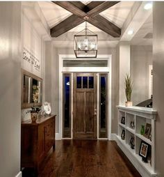I like the half-wall with the cube spaces to separate the entranceway