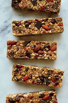 No-bake superfood granola bars - chewy granola bars packed full of superfood ingredients such as chia, pumpkin & linseeds, almonds, goji berries, oats, coconut oil & dark chocolate.