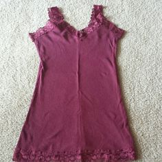 No Boundaries tank top size S Like new.  This is a cute burgundy v-neck tank top.  Lace trim around the bottom, lace neckline and straps.  Ribbed texture.  Super comfortable and great layering piece.  TANK TOP DEAL: any tank with this message is Buy 2, Get 1 FREE.  Please comment on one of the 3 items if you would like to take advantage of this deal BEFORE purchasing.  Please let me know if you have any questions! No Boundaries Tops Tank Tops