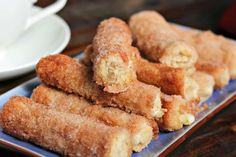 This Baked Cinnamon Cream Cheese Roll-Ups recipe is a simple process that yields an amazing churro-like breakfast treat. Just 20 minutes in the oven!