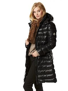 Moncler Moka Coat $1,150 -- Easy to throw on over ski clothes to dress up an apres-ski look. Layer it over cashmere when going out at night to complete your alpine dinner-out look.