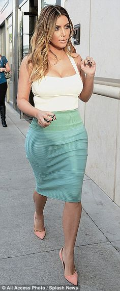 Hot mama! The Keeping Up With The Kardashians star showcased her incredible post-pregnancy body in a mint green pencil skirt and cream crop ...