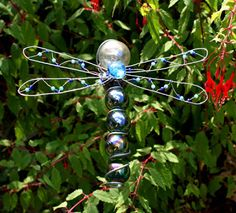 wire and glass ball garden sculpture ... dragonfly cane top
