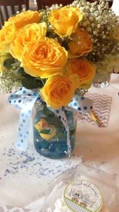 Boy baby shower centerpiece! Mason jar filled with hydrangeas, yellow roses, baby's breath, and a rubber ducky!