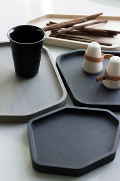 STONE WOODEN TRAY design inspired by brushed trace of zen painting. Develop to geometric shape to made a set of tray.