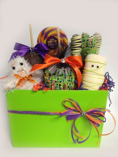Large Spooktacular Basket Includes 2 apples of your choice, 1 dizzy pop, 3 gourmet pretzels, 1 mummy marshmallow & a plush Boo ghost arranged in a lime green tote box. $52.00
