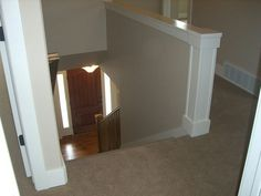 Instead of the open hand rail, build a solid knee wall for a bigger visual punch.
