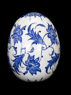A rare Iznik blue and white hanging ornament, Turkey, circa 1560, the stonepaste body of ovoid form, painted in cobalt blue with lotus blossoms 18cm. height