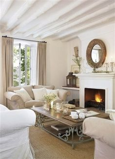 Round mirror above fireplace - idea for new house.