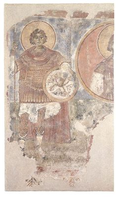 Date: 13th c.  Dimensions (cm): 266 X 246 Provenance: Episkopi, Evrytania  On the left stands St Orestes, full-length, frontal, in military dress and holding a shield and spear.  On the right, in a round frame with a red ground, is depicted St. Eugenios, bust length and holding a cross