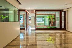 Flachdach Haus mit Hof - zeitgemäße Architekturlösungen aus Indien