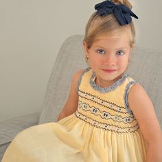 Girls yellow, sleeveless dress and hairband set by Pretty Originals, with stripe… Ensemble fille et robe jaune sans manches et … Smocking Baby, Smocking Patterns, Baby Dress Patterns, Sewing Patterns, Smocked Baby Clothes, Girls Smocked Dresses, Baby Girl Dresses, Little Girl Outfits, Cute Outfits For Kids