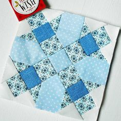 Block 340 - Heather. Paper-pieced Farmer's Wife 1930s block that looks a lot like a snowflake in these blues.