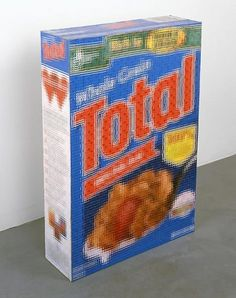 Tom Friedman - Cereal boxes- Nine Total cereal boxes cut into small squares and combined to make one larger box