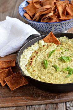 A great Super Bowl recipe! Baked Pesto Goat Cheese Dip is awesome served warm with pita chips or fresh veggies | mountainmamacooks.com