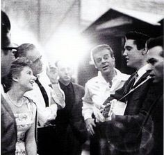 """Elvis candid on the set of """"King Creole"""" with some of his co-stars"""