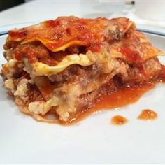 At World's Best Lasagna, with million views. Recipe makers used million lasagna noodles! This is an AMAZING lasagna! I used some different cheeses Entree Recipes, Top Recipes, Pasta Recipes, Beef Recipes, Dinner Recipes, Cooking Recipes, Worlds Best Lasagna, Best Lasagna Recipe, My Favorite Food