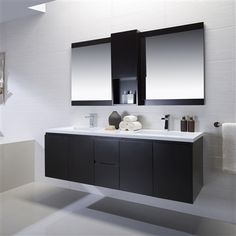 This black solid surface double sink vanity is great for any monochromatic or modern bathroom. Bathroom Styling, Floating Vanity, Bathroom Furniture, Bathroom Design, Double Vanity Bathroom, Floating Bathroom Vanities, Rustic Bathrooms, Vanity Sink, Contemporary Bathroom Decor