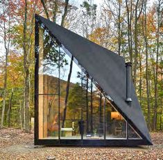 Tiny Cabin in the Woods Exhibits a Unique Crystal Shape envisioned by Copenhagen- and New York-based architects BIG