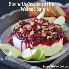 Brie with Cranberries and Walnuts, serve with apples, pears or crackers.